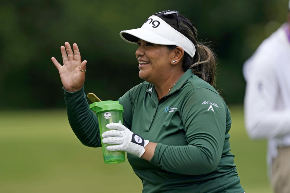 Lizette Salas waves to a spectator on the ninth tee box during the second round of play in the KPMG Women's PGA Championship golf tournament Friday, June 25, 2021, in Johns Creek, Ga. (AP Photo/John Bazemore)