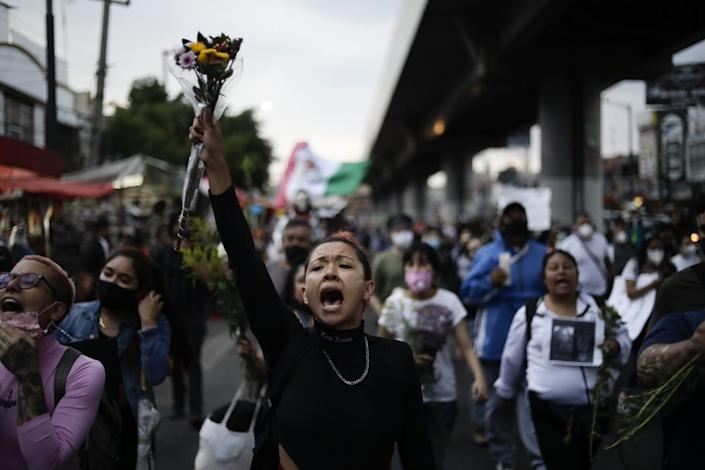 A woman shouts during a march demanding justice for the people who died in Monday's subway collapse