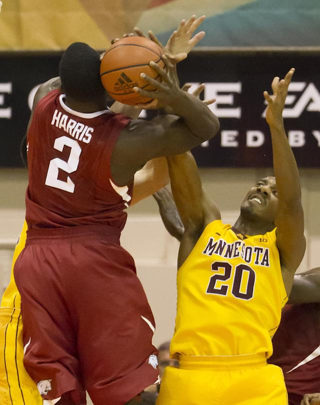 Arkansas forward Alandise Harris (2) wrestles away a rebound from Minnesota guard Austin Hollins (20) in the first half of an NCAA college basketball game at the Maui Invitational on Tuesday, Nov. 26, 2013, in Lahaina, Hawaii. (AP Photo/Eugene Tanner)