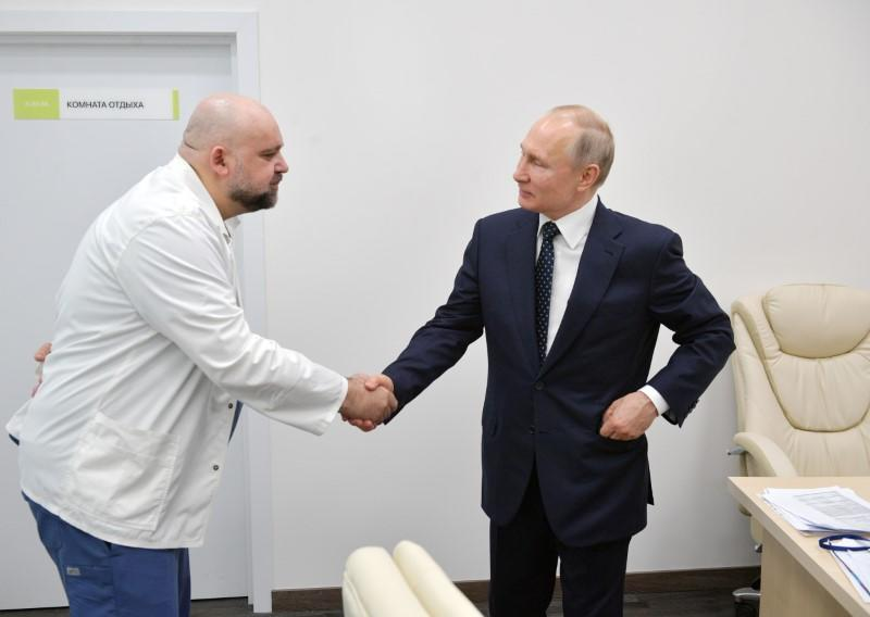Russian PresidentPutin visits a hospital for patients infected with coronavirus disease (COVID-19) on the outskirts of Moscow