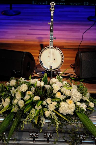 Earl Scruggs' banjo is displayed center stage during his funeral service at the Ryman Auditorium on Sunday, April 1, 2012, in Nashville, Tenn. Scruggs died on Wednesday, March 28, 2012. He was 88. (AP Photo/Joe Howell, Pool)