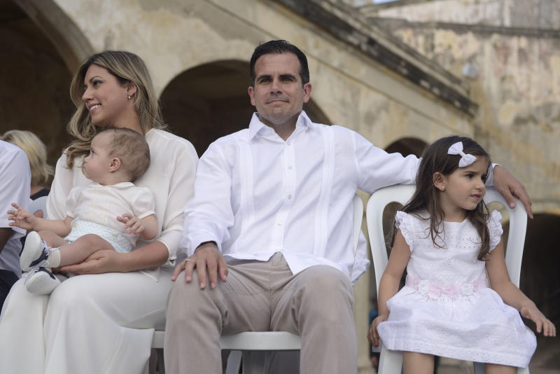Puerto Rico Governor Ricardo Rossello sits with his wife Beatriz and kids, Pedro Javier and Claudia during a remembrance ceremony convened by Governor Ricardo Rossello at the San Cristobal Castle, on the anniversary of Hurricane Maria, in San Juan, Puerto Rico, Thursday, September 20, 2018. Hurricane Maria left almost three thousand dead, caused economic losses amounting hundreds of millions of dollars and left a path of destruction and damaged infrastructure through the island. (AP Photo Carlos Giusti)