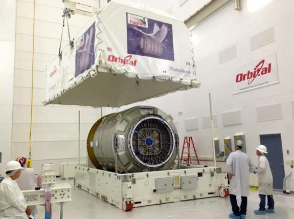 """Orbital Sciences Cygnus spacecraft, the """"Spaceship C. Gordon Fullerton,"""" is seen in July 2013 after arriving at NASA's Wallops Flight Facility in Virginia for pre-launch processing."""