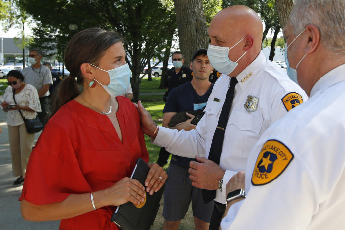 FILE - In this Aug. 3, 2020 file photo, Salt Lake City Mayor Erin Mendenhal and Salt Lake City police Chief Mike Brown speak following a news conference in Salt Lake City. The Salt Lake City Police Department vowed Tuesday, Sept. 8, 2020, to cooperate with multiple investigations of the shooting of a 13-year-old autistic boy by officers in the Salt Lake City area. The Salt Lake City Police Department said the officers were called to a home in Glendale, Utah, Friday night, Sept. 4 with a report of a boy who had threatened people with a weapon. The boy reportedly ran and was shot by an officer after being pursued by police. (AP Photo/Rick Bowmer, File)