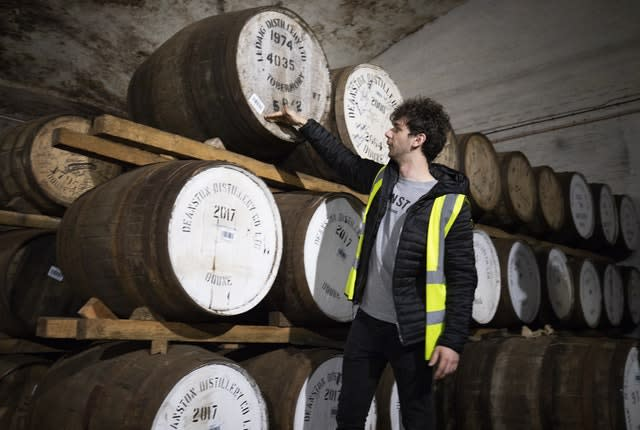 Ronnie Brodie at Deanston Distillery in Doune, checks the casks of their Highland Single Malts