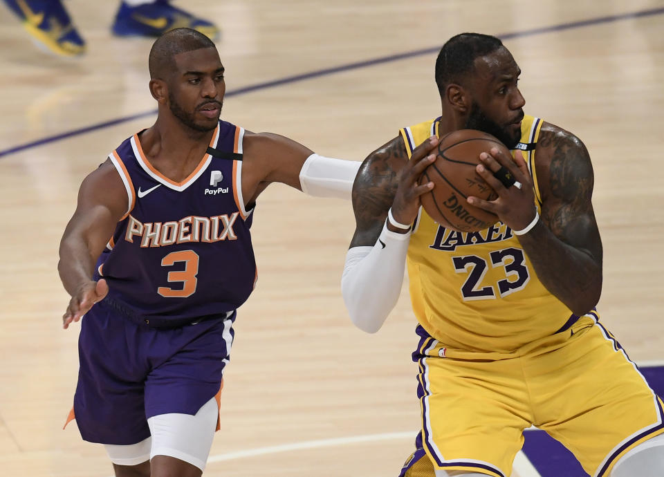 LeBron James is fouled by Chris Paul.