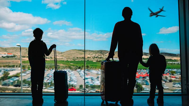 Silhouettes of people at an airport