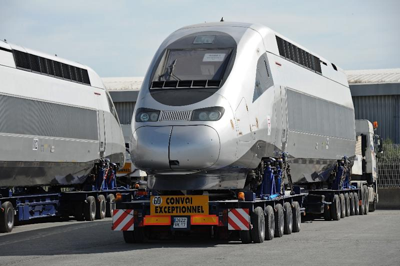 In this file photo taken on June 26, 2015, a carriage of a high-speed train TGV produced by Alstom is loaded on a ship leaving for Tangiers, Morocco, at La Rochelle's harbour. (AFP Photo/Xavier LEOTY)