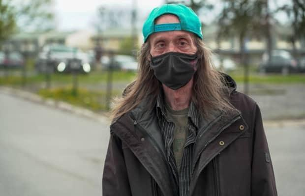Apartment resident Blaine Scott says if it weren't for the program, it's likely he wouldn't have gotten vaccinated at all.