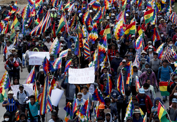 Coca growers, supporters of former President Evo Morales, march in Cochabamba, Bolivia, Monday, Nov. 18, 2019. Morales, Bolivia's first indigenous president, claimed victory after the vote, but opponents alleged fraud and massive protests began. An international audit concluded there were election irregularities and Morales resigned Nov. 10. (AP Photo/Juan Karita)