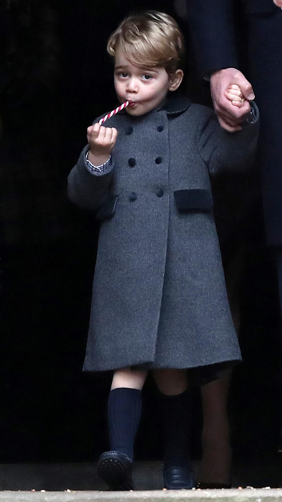 Prince George, the son of the Duke and Duchess of Cambridge, sucks a sweet as he leaves following the morning Christmas Day service at St Mark's Church in Englefield, near Bucklebury in southern England, Britain, December 25, 2016. REUTERS/Andrew Matthews/Pool