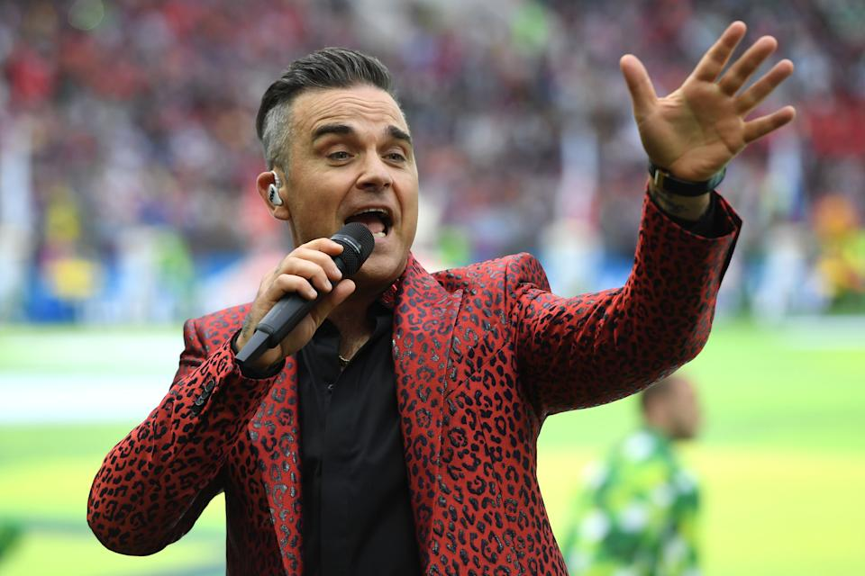 English musician Robbie Williams performs during the Russia World Cup opening ceremony before the tournament's first match between Russia and Saudi Arabia on June 14, 2018 at Moscows Luzhniki Stadium. (Photo by Patrik STOLLARZ / AFP)        (Photo credit should read PATRIK STOLLARZ/AFP via Getty Images)