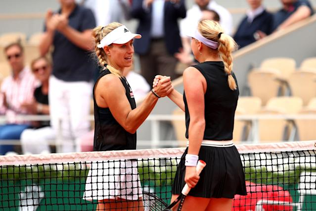 "<a class=""link rapid-noclick-resp"" href=""/olympics/rio-2016/a/1126199/"" data-ylk=""slk:Angelique Kerber"">Angelique Kerber</a> congratulates Anastasia Potapova on her upset during day one of the French Open. (Photo by Clive Brunskill/Getty Images)"