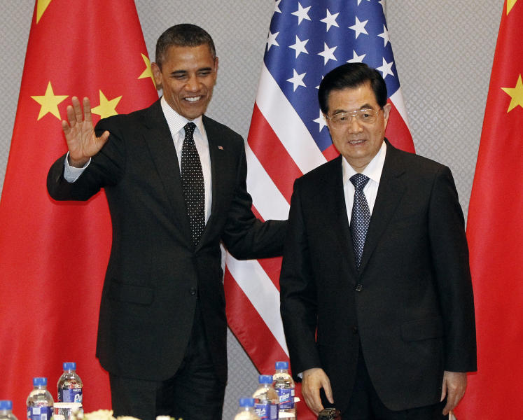 "FILE - In this March 26, 2012, file photo President Barack Obama, left, greets Chinese President Hu Jintao at the start of their bilateral meeting in Seoul, South Korea. Obama's ""pivot"" to China's neighborhood and the ""reset"" in relations with Russia have produced limited results for signature foreign policy initiatives designed to improved America's standing with its former Cold War rivals. Attention returns to China this coming week when Secretary of State Hillary Rodham Clinton and Treasury Secretary Timothy Geithner attend strategic and economic talks in Beijing. (AP Photo/Pablo Martinez Monsivais, File)"