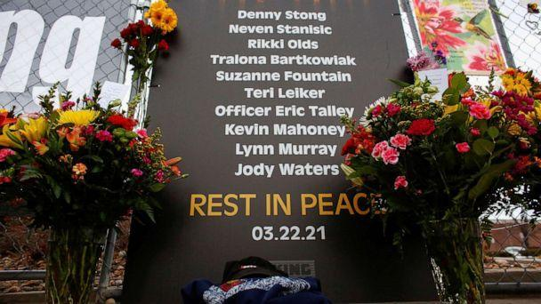 PHOTO: A sign honoring the 10 victims adorns a fence at the site of a mass shooting at a King Soopers grocery store in Boulder, Colo., March 23, 2021. (Kevin Mohatt/Reuters)