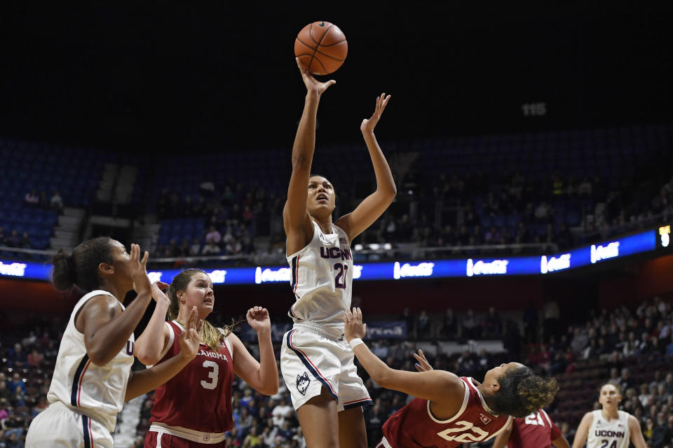 Connecticut's Olivia Nelson-Ododa (20) shoots a basket while fouled by Oklahoma's Ana Llanusa (22) in the second half of an NCAA college basketball game, Sunday, Dec. 22, 2019, in Uncasville, Conn. (AP Photo/Jessica Hill)
