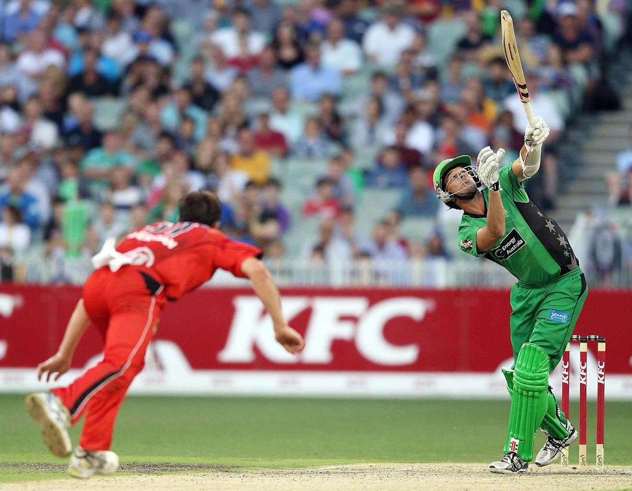 MELBOURNE, AUSTRALIA - JANUARY 06:  Clint McKay of the Melbourne Stars hits the ball and gets caught off the bowling of Will Sheridan of the Melbourne Renegades during the Big Bash League match between the Melbourne Stars and the Melbourne Renegades at Melbourne Cricket Ground on January 6, 2013 in Melbourne, Australia.  (Photo by Michael Dodge/Getty Images)