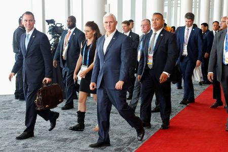 U.S. Vice President Mike Pence reacts as he walks past China's President Xi Jinping (not pictured) while leaving APEC Haus, during the APEC Summit in Port Moresby