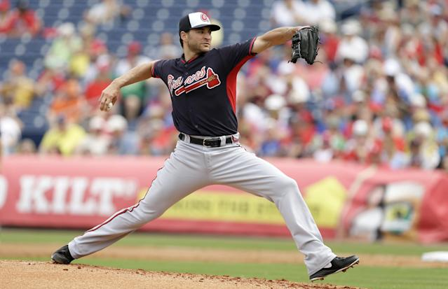 Atlanta Braves starting pitcher Brandon Beachy throws a pitch during the first inning of an exhibition baseball game against the Philadelphia Phillies Wednesday, March 5, 2014, in Clearwater, Fla. (AP Photo/Charlie Neibergall)