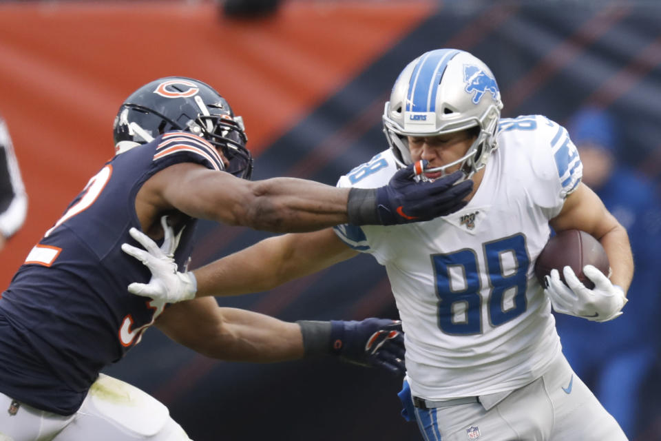 Chicago Bears outside linebacker Khalil Mack (52) hits Detroit Lions tight end T.J. Hockenson (88) in the face mask during the second half of an NFL football game in Chicago, Sunday, Nov. 10, 2019. (AP Photo/Charles Rex Arbogast)