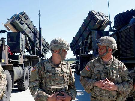 FILE PHOTO: U.S. soldiers stand next to the long-range air defence system Patriot during Toburq Legacy 2017 air defence exercise in the military airfield near Siauliai, Lithuania, July 20, 2017. REUTERS/Ints Kalnins/File Photo
