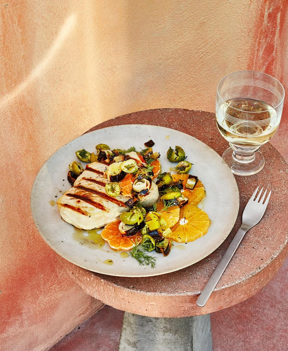 "Firm, thick swordfish steaks can handle being cooked over medium-high heat like a steak. An even higher temp chars the leeks so that they're smoky outside and sweet and juicy inside. <a href=""https://www.bonappetit.com/recipe/grilled-swordfish-with-charred-leeks-and-citrus?mbid=synd_yahoo_rss"" rel=""nofollow noopener"" target=""_blank"" data-ylk=""slk:See recipe."" class=""link rapid-noclick-resp"">See recipe.</a>"