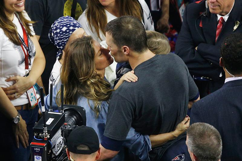 Gisele Bundchen celebrates with husband Tom Brady after the New England Patriots' victory in the 2017 Super Bowl (Bob Levey via Getty Images)