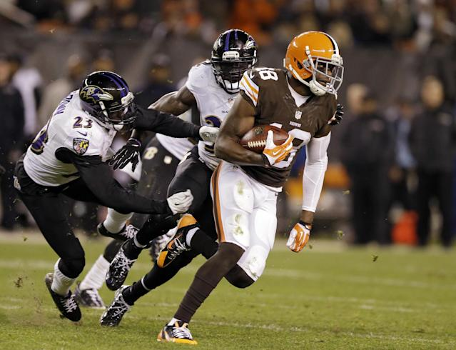 Cleveland Browns wide receiver Greg Little (18) runs away from Baltimore Ravens defensive back Chykie Brown in the fourth quarter of an NFL football game Sunday, Nov. 3, 2013, in Cleveland. Little caught 7 passes for 122 yards in the Browns' 24-18 win. (AP Photo/Tony Dejak)