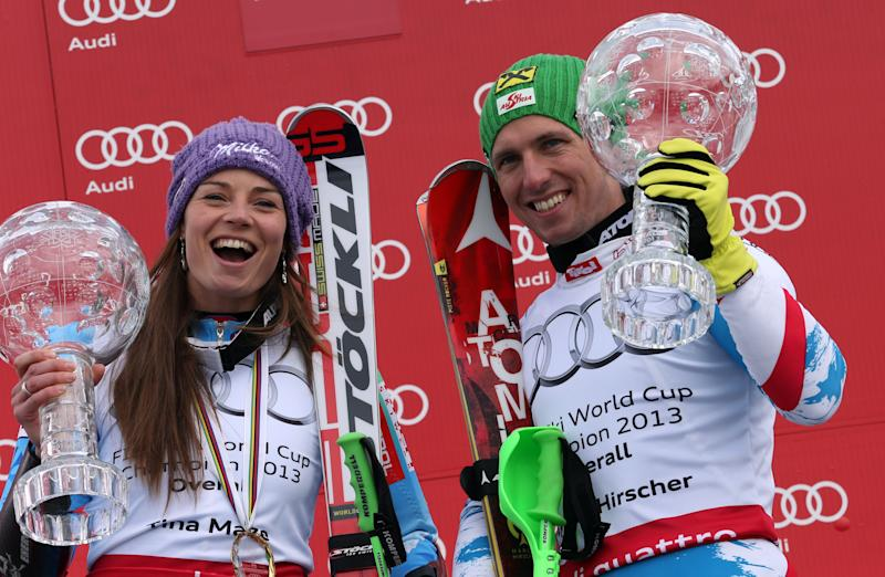 Slovenia's Tina Maze and Austria's Marcel Hirscher pose with their alpine ski World cup overall trophies in Lenzerheide, Switzerland, Sunday 17, March 2013. (AP photo/Armando Trovati)