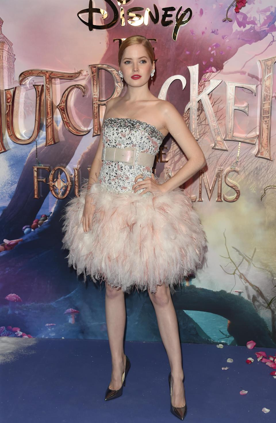 <p>Like her co-star Keira, Ellie wowed in a glitzy Chanel number complete with feather skirt. <em>[Photo: Getty]</em> </p>