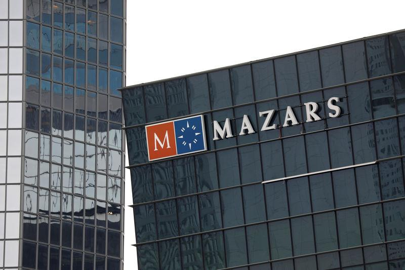 FILE PHOTO: The logo of Mazars, an international, integrated organisation, that is specialised in audit, accounting, tax and advisory services is seen on a building in the financial district of la Defense near Paris
