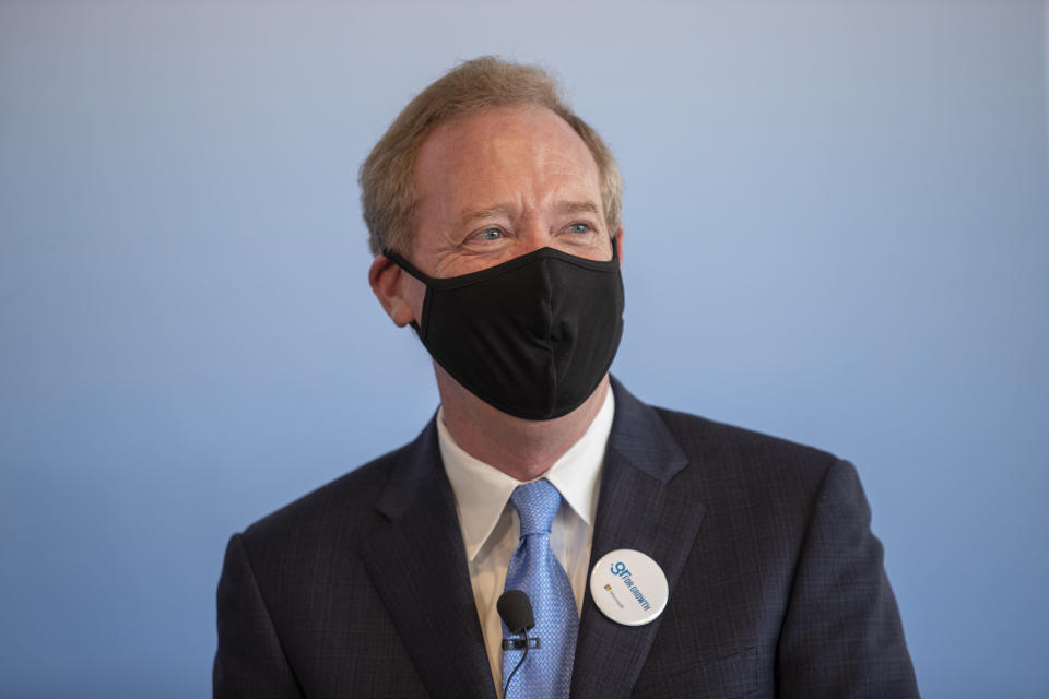 Microsoft President Brad Smith wearing a mask to prevent the spread of the coronavirus attends a ceremony held in the Acropolis Museum, central Athens, on Monday, Oct. 5, 2020. Microsoft has announced plans to build three data centers in greater Athens, providing a badly needed investment of up to $1 billion to the Greek economy which has been hammered by the pandemic. (AP Photo/Petros Giannakouris)