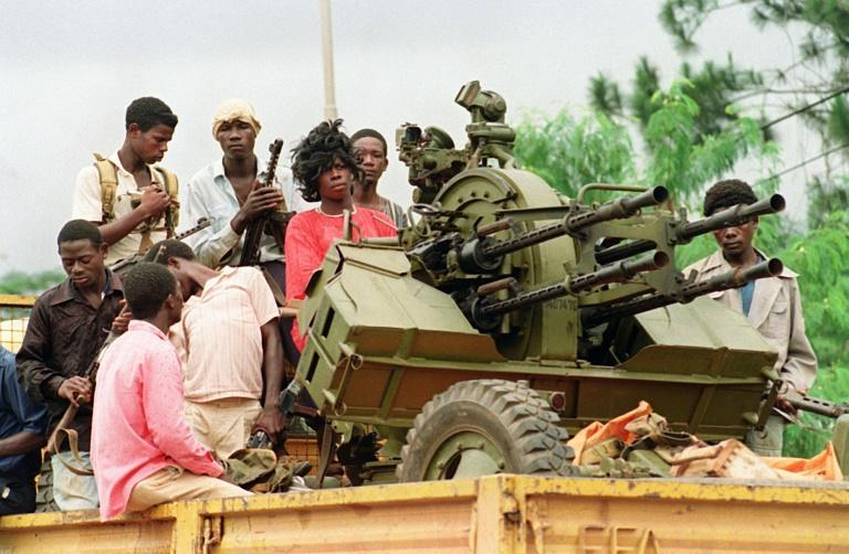 Rebels loyal to warlord Charles Taylor patrol Monrovia's streets in August 1990 during Liberia's first civil war