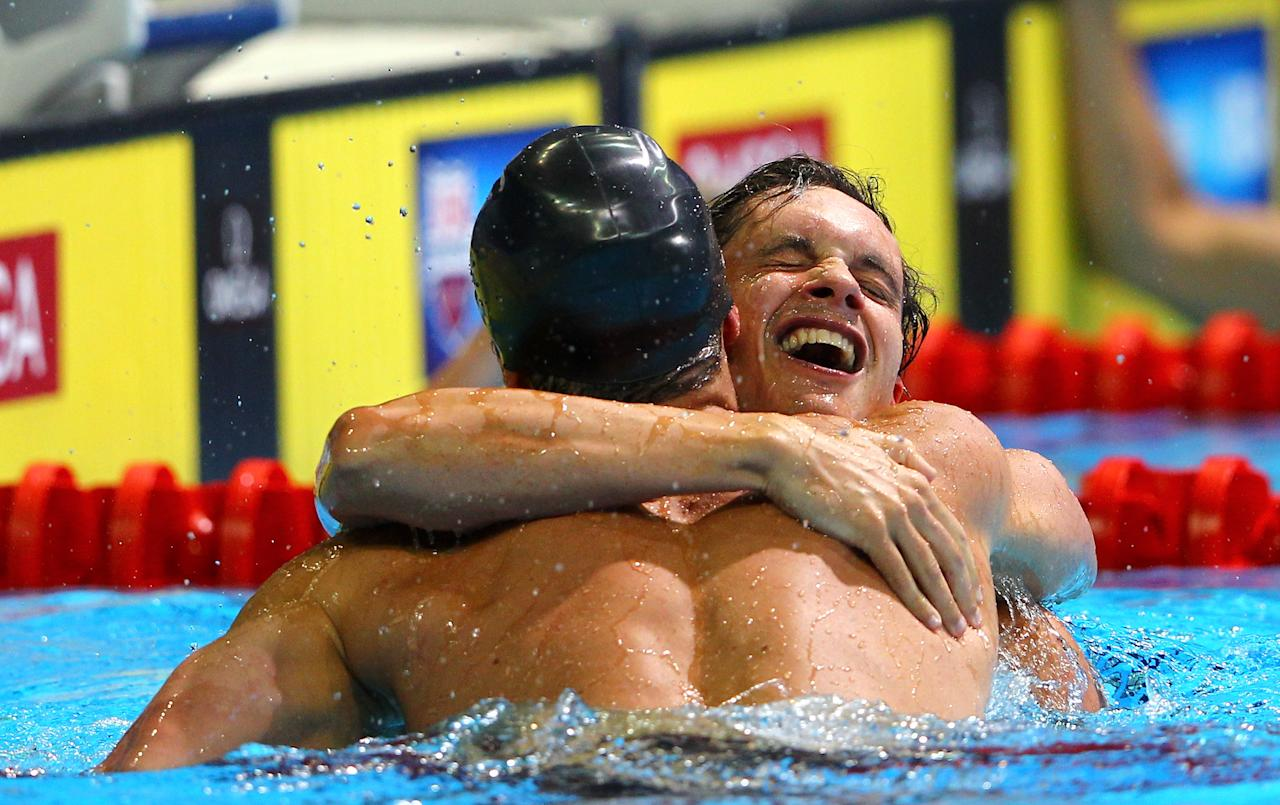 OMAHA, NE - JUNE 26:  (L-R) Brendan Hansen and Eric Shanteau celebrate after they competed in the championship final heat of the Men's 100 m Breaststroke during Day Two of the 2012 U.S. Olympic Swimming Team Trials at CenturyLink Center on June 26, 2012 in Omaha, Nebraska.  (Photo by Al Bello/Getty Images)