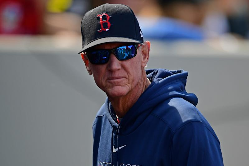 Ron Roenicke looks in the dugout during a game.
