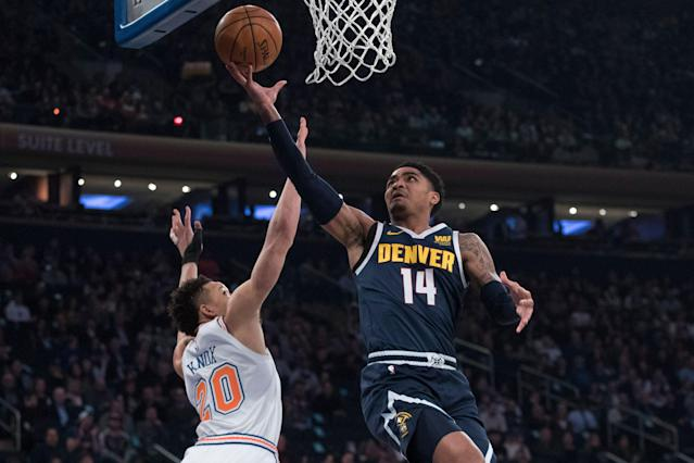 Former Spartan Gary Harris goes to the basket Friday night against Kevin Knox and the Knicks. (AP)