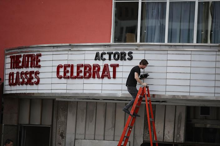 Matt Scally takes the letters of the marquee at the Actors' Playhouse at the Miracle Theatre as they prepare for Hurricane Irma on September 6, 2017 in Miami.