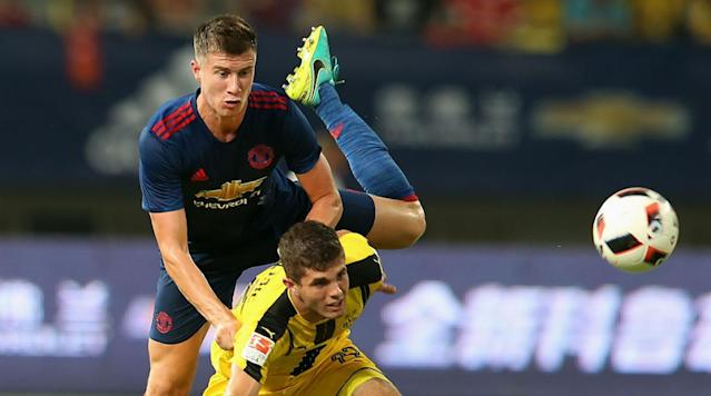 <p>Patrick McNair of Manchester United in action with Christian Pulisic of Borussia Dortmund during the pre-season friendly match at Shanghai Stadium on July 22, 2016 in Shanghai, China.</p>