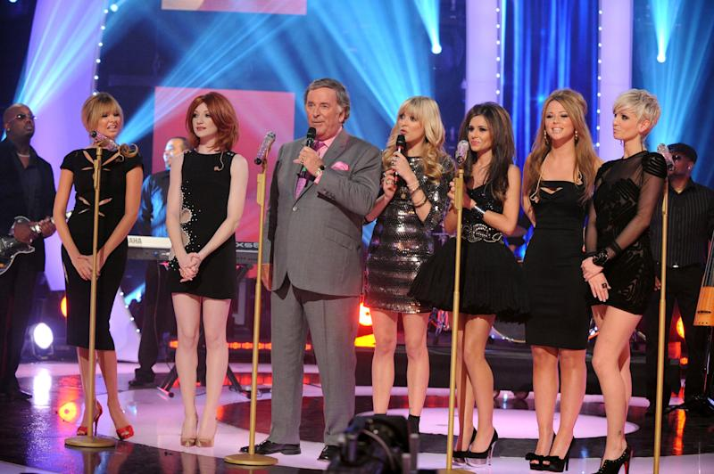 Girls Aloud are joined on stage by Terry Wogan and Fearne Cotton, centre, during the filming of the BBC's Children in Need Appeal 2008 at BBC Television Centre, in central London.