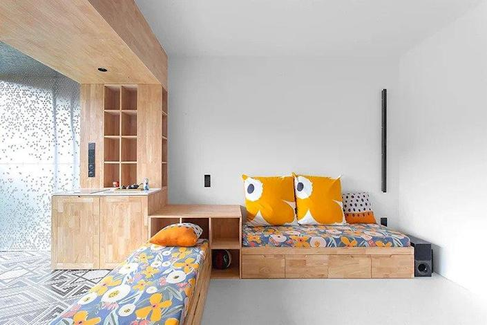 Built-in wood furniture makes up the Live and Fun apartment's living and dining areas.