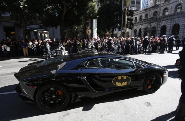 """The Batmobile carrying five-year-old leukemia survivor Miles, aka """"Batkid"""", is seen as part of a day arranged by the Make-A-Wish Foundation in San Francisco, California November 15, 2013. The young cancer survivor will be treated to various super hero scenarios including receiving a commendation at San Francisco City Hall. REUTERS/Stephen Lam (UNITED STATES - Tags: SOCIETY)"""