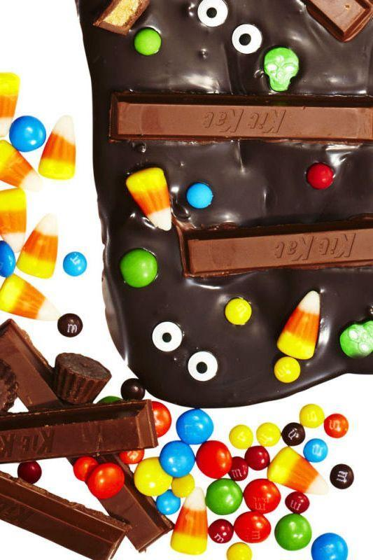 """<p>You have to dump all of that leftover candy somewhere, so why not pour some in a layer of melted chocolate? </p><p><a href=""""https://www.goodhousekeeping.com/holidays/halloween-ideas/a34763/halloween-chocolate-candy-bark/"""" rel=""""nofollow noopener"""" target=""""_blank"""" data-ylk=""""slk:Get the recipe for Halloween Candy Bark »"""" class=""""link rapid-noclick-resp""""><em>Get the recipe for Halloween Candy Bark »</em></a><br></p>"""