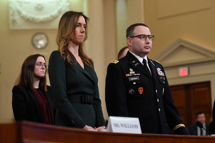 Jennifer Williams, a foreign policy aide to Vice President Mike Pence, 2nd from left, and Lieutenant Colonel Alexander Vindman, a Ukraine expert for the National Security Council, arrive to testify on Nov. 19, 2019 before the Permanent Select Committee on Intelligence in a public hearing in the impeachment inquiry into allegations President Donald Trump pressured Ukraine to investigate his political rivals.