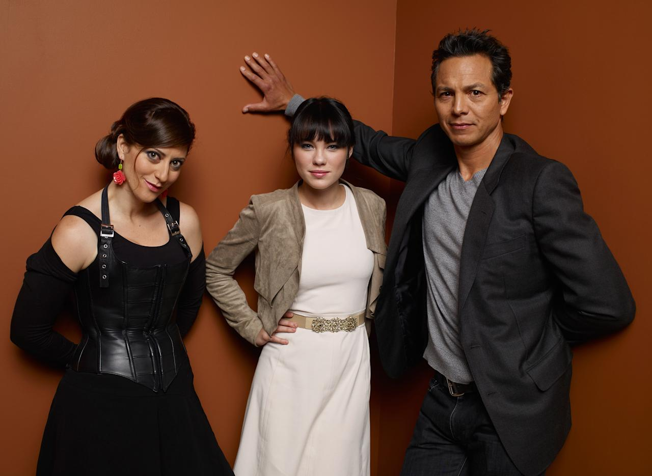 """TORONTO, ON - SEPTEMBER 09:  (L-R) Director Anita Doron, actress Chloe Rose and actor Benjamin Bratt of """"The Lesser Blessed"""" pose at the Guess Portrait Studio during 2012 Toronto International Film Festival on September 9, 2012 in Toronto, Canada.  (Photo by Matt Carr/Getty Images)"""