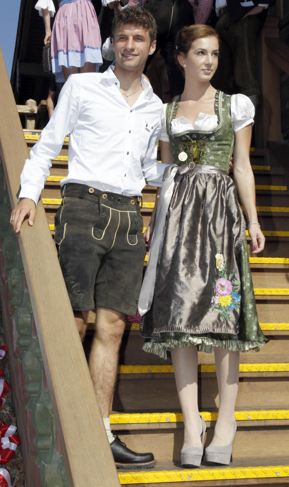 Thomas Mueller, right, of Bayern Munich soccer club and his wife Lisa arrive at a beer tent during the 178th Oktoberfest beer festival in Munich, southern Germany, on Sunday, Oct. 2 , 2011. (AP Photo/Matthias Schrader)
