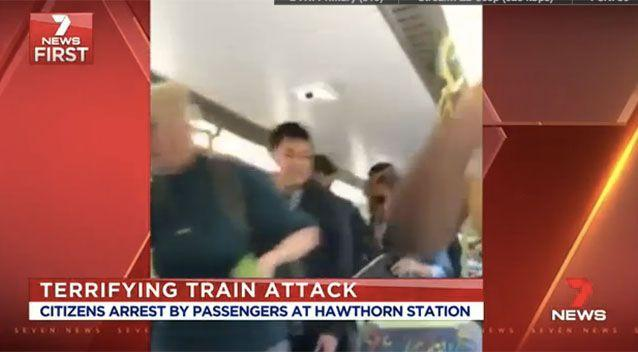 Phone footage shows passengers running off the train. Source: 7News