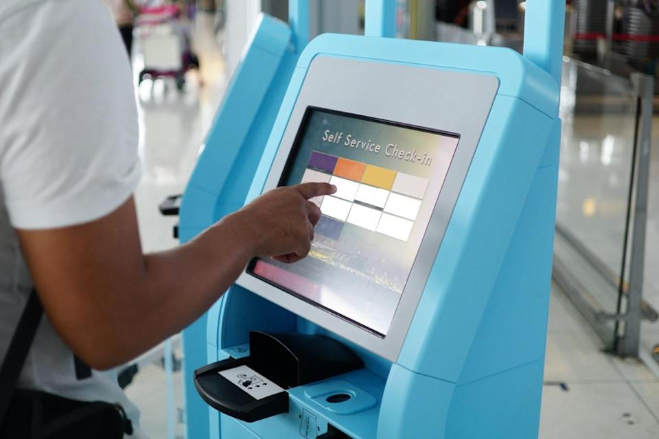 Close-up self service check in for flight or buying airplane tickets at airport