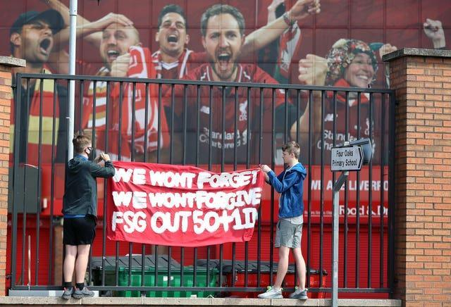 Liverpool fans protest against the clubs owners outside Anfield ahead of the game against Newcastle