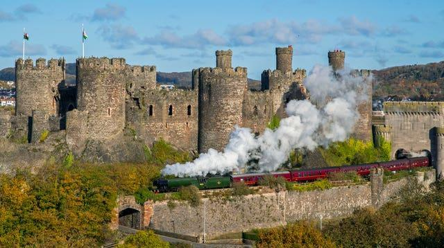 The Flying Scotsman passes Conwy Castle, North Wales (Peter Byrne/PA)