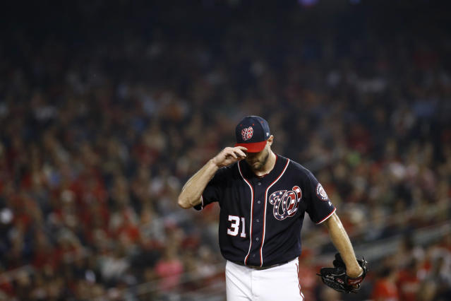Washington Nationals starting pitcher Max Scherzer pauses in the fourth inning of the team's baseball game against the Atlanta Braves, Friday, Sept. 13, 2019, in Washington. Atlanta scored two runs against Scherzer in the fourth. (AP Photo/Patrick Semansky)